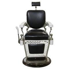 1930s Paider Barber Chair with Black Leather Upholstery and White Porcelain
