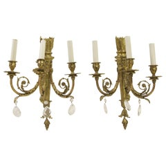 1930s Pair of French Torche Brass Three-Arm Sconces with Teardrop Srystals
