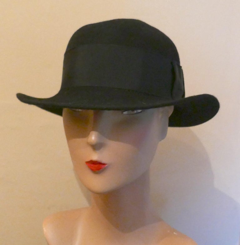 """1930s Black Cloche Felt Hat   A Great Classic piece in great condition, the Hat has a 2"""" twill hat band and measures 57cm around the inside band This is a genuine vintage piece and in good condition.   B23"""