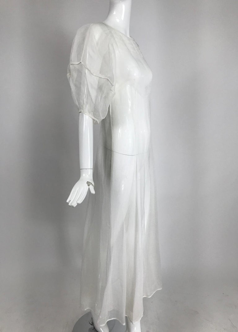 1930s Sheer white organza, lantern sleeve, gored skirt maxi dress, handmade. This beautiful dress is in amazing condition, from the 1930s it was handmade by an accomplished seamstress. It would make a lovely wedding dress.      The dress slips