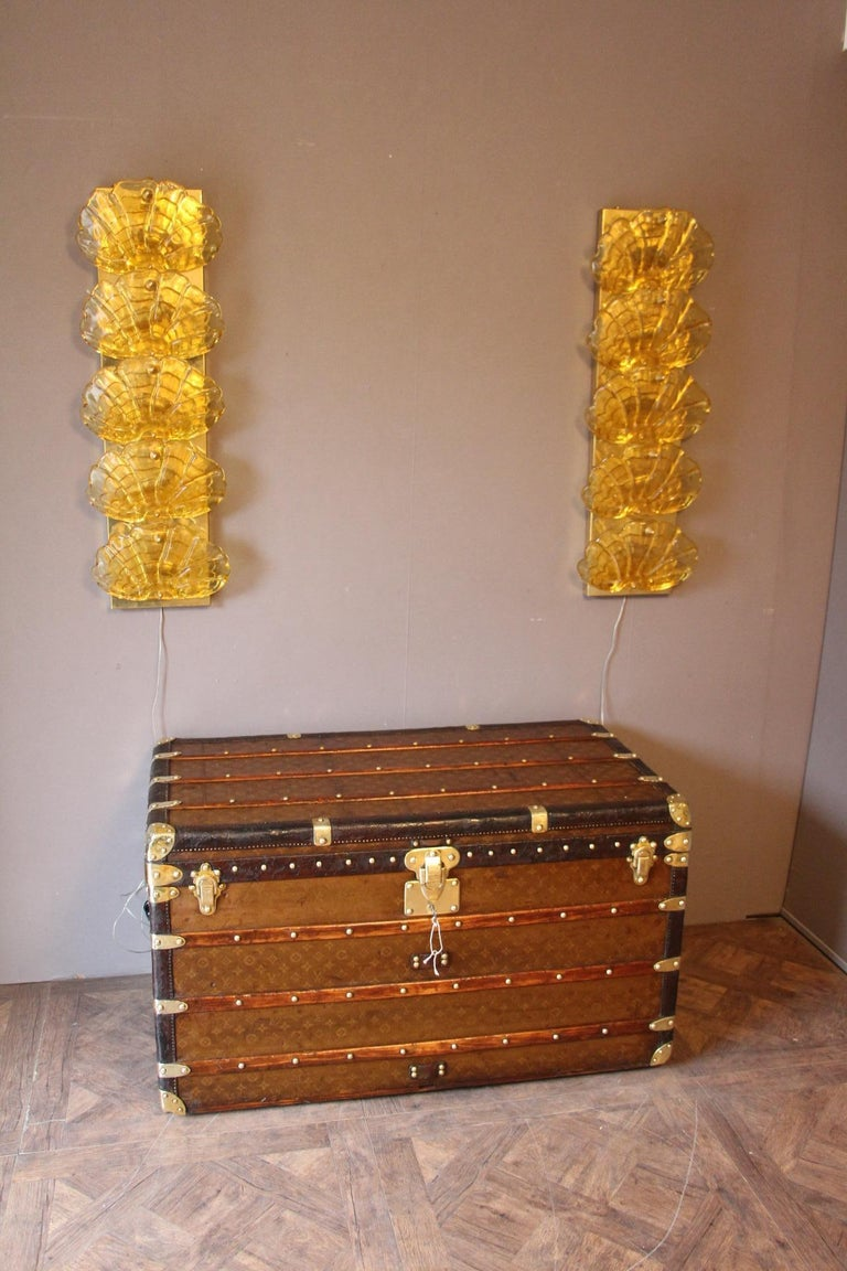 This magnificent Louis Vuitton steamer trunk is top of the range as far as it features leather trim, solid brass corners and all LV stamped locks, studs as well as side handles. Moreover it has got a very warm and elegant patina.