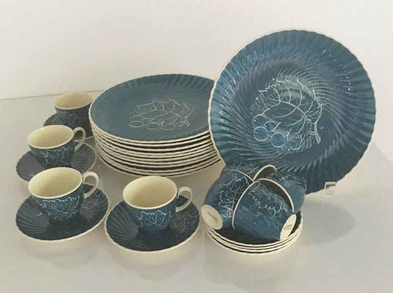 Susie Copper's 1930s Breakfast / Luncheon set of 8 Demitasse cups / saucers and 12 plates in blue background and white hand painted underglaze decoration of Grape Leaves and Grapes. The plates' and saucers' rims with a swirl or scalloped pattern.