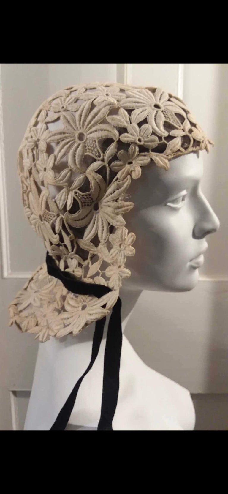 1930s Suzanne Rémy Belgian Lace Art Deco Joan of Arc Style Helmet Cloche Wedding Hat.   Suzanne Rémy trained with Schiaparelli and was the head milliner at Agnes of Paris before emigrating to the US after WW2 and opening a millinery shop with Roger