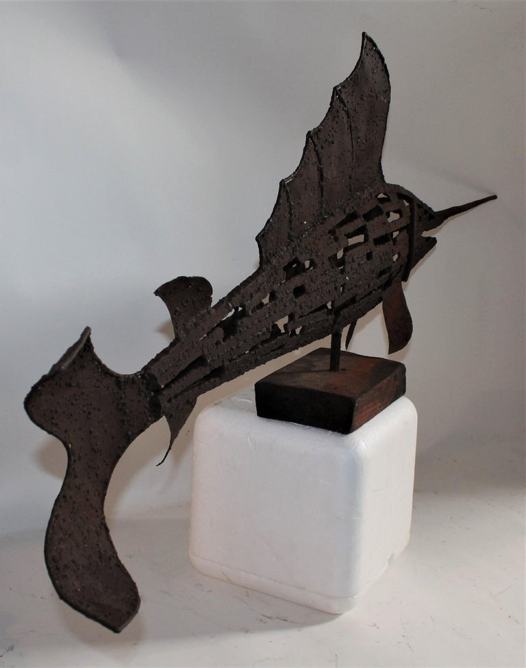 Early 20th century swordfish folk sculpture in good condition on original wood block base. This cast iron handmade sculpture is in great condition and very heavy. Resembles a large handmade weather vane. Great form!
