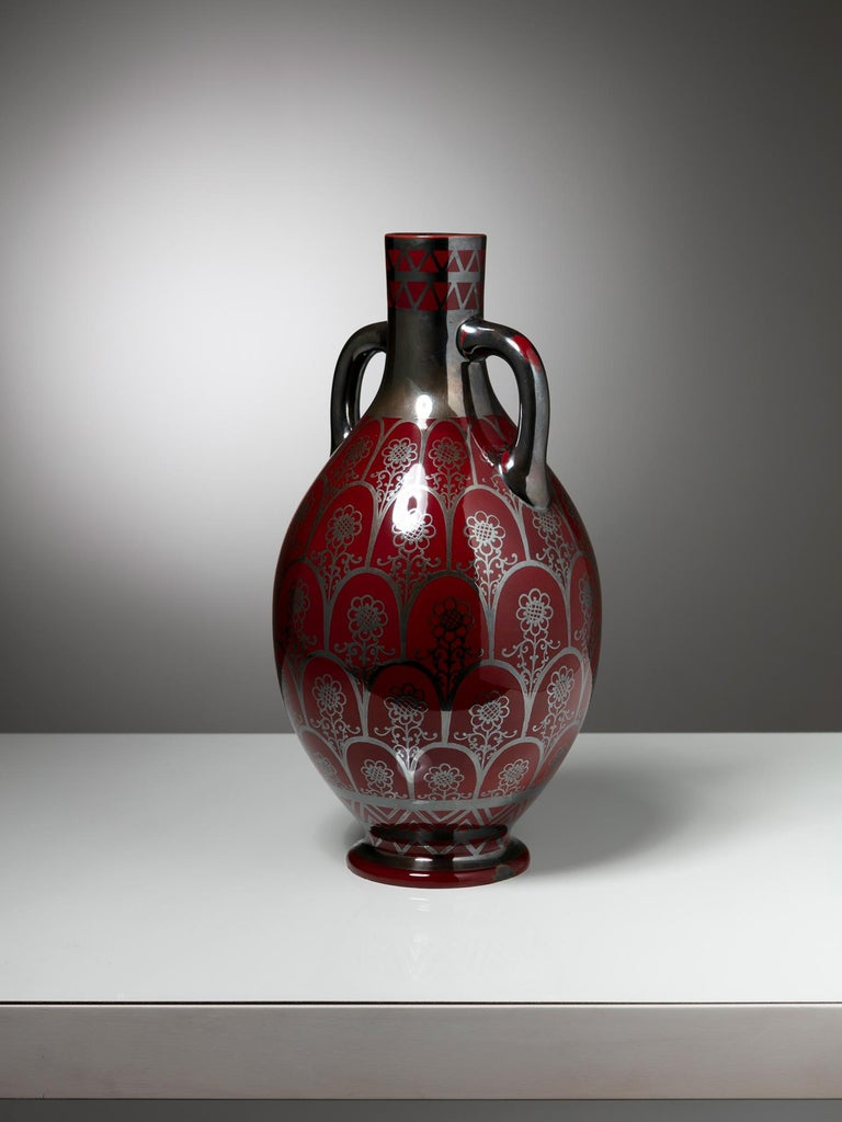 Large ceramic vase by Righard Ginori. Dark red background with silver decoration.
