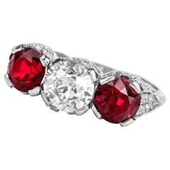 1930s Vintage Ruby Diamond Three-Stone Platinum Three-Stone Ring