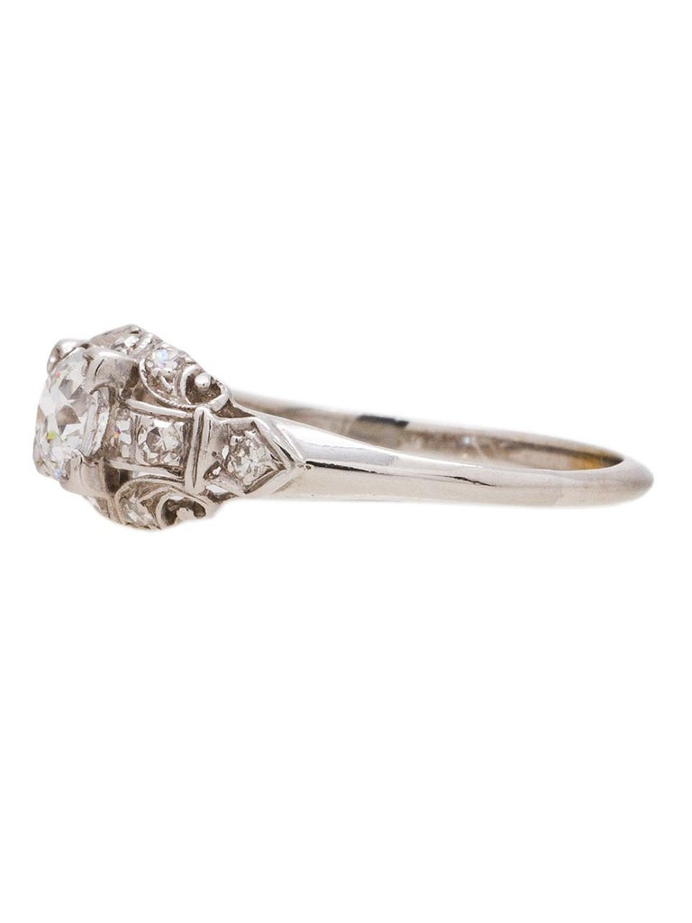 This engagement ring is set in 18k white gold with a beautiful 0.46 carat old European cut diamond, H color and VS2 clarity. With 12 accent diamonds adding 0.24 carat. Nice detail with open work with scroll design. Precious and unique ring. Size
