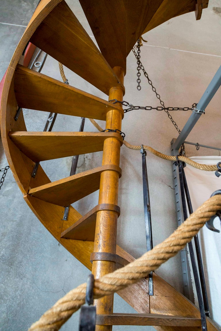 An antique, wood and veneer, spiral staircase made in France in the 1930s standing 14 feet tall (169
