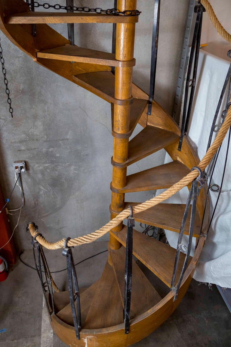 1930s Wood Spiral Staircase with Wrought Iron Balusters and Rope Railing In Good Condition For Sale In San Francisco, CA
