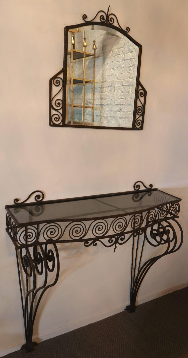 1930s wrought iron console with glass top and matching mirror.
