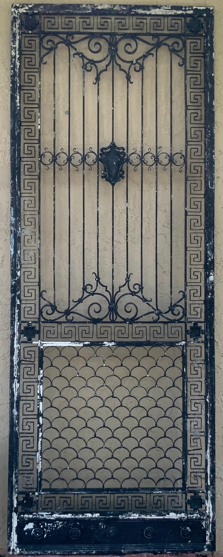 Exceptional iron door with artistic metalwork ,surrounded by beautiful Greek-key motifs this door has history as we acquire it and inspect it ,it was originally part of a gate ,then later added six legs and become coffee table , later in time the