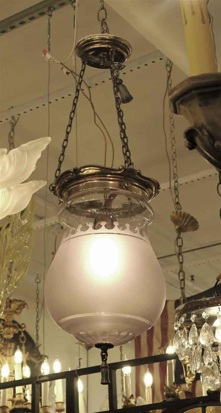 These are the original 1931 EF Caldwell bell jar fixtures from the 41st floor corridor of the Towers of the Waldorf Astoria Hotel. They are signed Caldwell. Some of the shades have a soft purple hue. Early glass had manganese, which turns color with