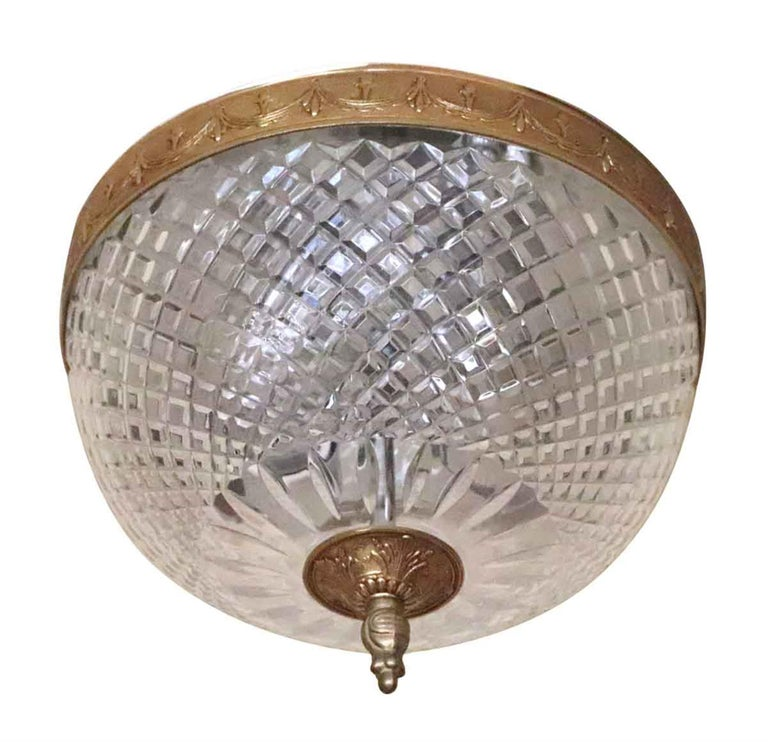 1931 Italian flush mount light with Slovakian cut crystal globe and a brass decorative rim and finial. These lights adorned various corridors of the towers of the NYC Waldorf Astoria Hotel. Possible variations in details such as the finial and