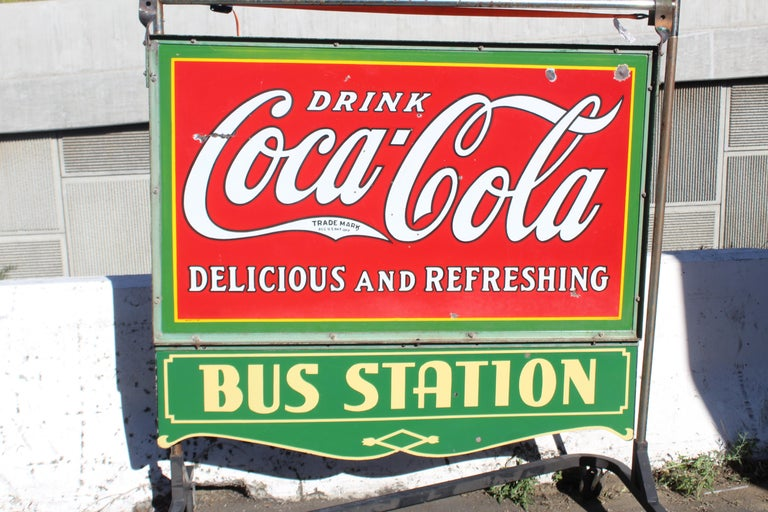 Original double sided hanging coca cola sign with original bracket.