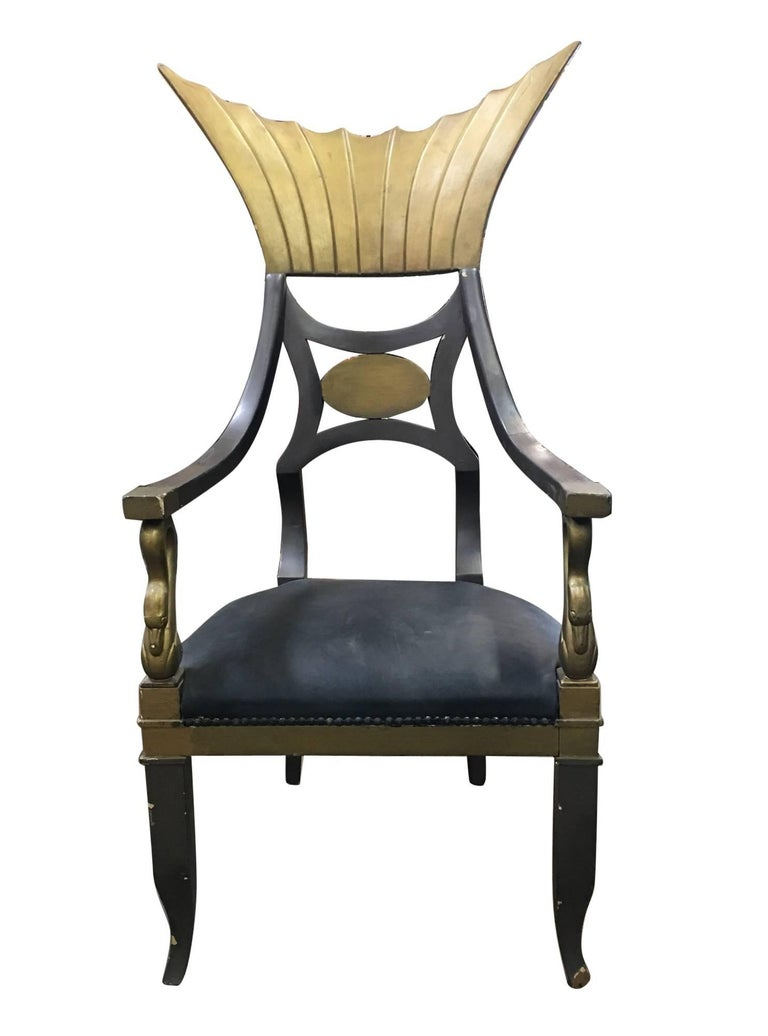 Original Egyptian throne chair used in the classic 1934 Claudette Colbert Film Cleopatra, from Paramount Studios. The dramatic chair, in which the star sat, can be seen in the scenes of Cleopatra's bed chamber. The chair embodies the style and