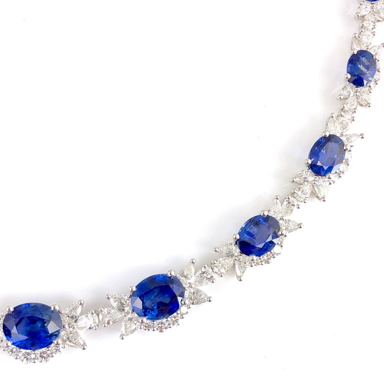 This elegant necklace features 13 oval cut blue sapphires totaling 21.46 carats, embellished by pear shape and round diamond accents totaling 13.82 carats. oval cut blue sapphires total 21.46 carats Pear shape and round diamonds total 13.82