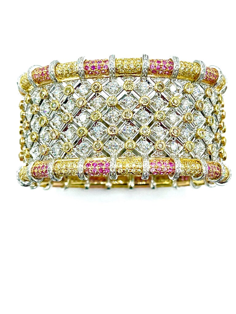 This is an absolutely stunning bracelet!  The bracelet contains a total of 836 round brilliant Diamonds for a total weight of 19.36 carats.  The Diamonds are prong set and bezel set all the way around the entire bracelet in white and yellow 18K