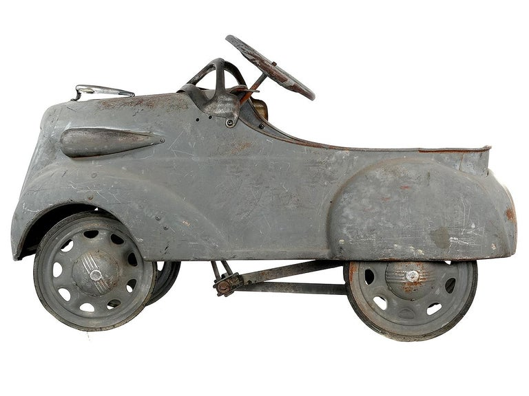 This is a very hard to find 1936 Steelcraft Ford V8 pedal car sedan coupe roadster. The car has a nice weathered patina with just the right look.