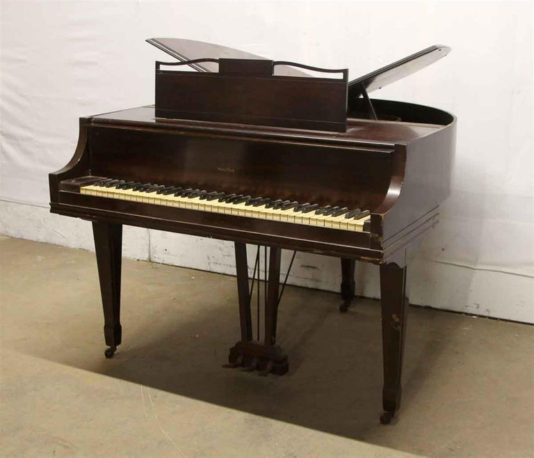 Rare butterfly baby grand piano built by the Rudolph Wurlitzer Piano & Organ Company in 1937. Wurlitzer built a limited number of these piano's during the 1930s and 1940s. Sought after by collectors and musicians alike. Needs restoration. This can
