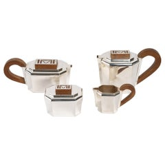 1937 Jean E. Puiforcat, Tea and Coffee Service in Sterling Silver and Walnut