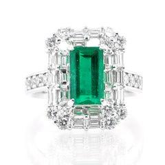 1.94 Carat Natural Emerald and Diamond Art Deco Inspired Ring Set in Platinum
