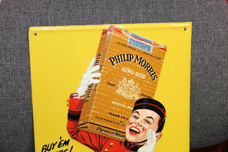 This embossed tin sign has a great Bell Boy Graphic. Sign was made by Stout Sign Co.