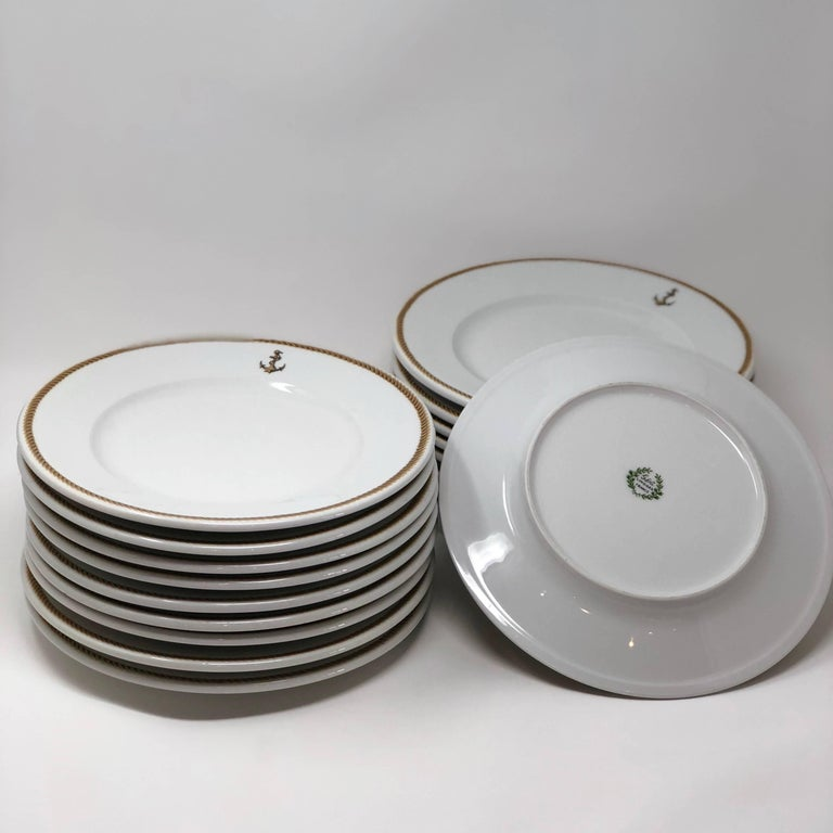 The set of 18 plates has a stamp, from Gerard, Dufraisseix, and Abbot in Limoges France. I believe judging from the stamp and the size of the plate, the dinner plates are possibly 1940s era. Naval Insignia of Gold Fouled Anchor. Great vintage