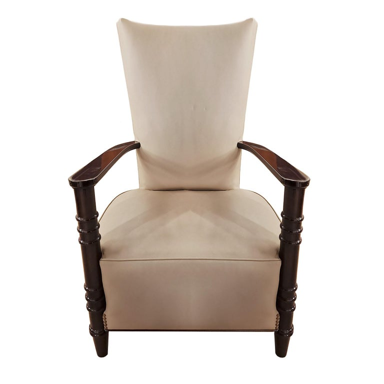 Elegant Art Deco style armchair with high back, French polished wood and beige-grey leather upholstery.  France, c. 1940.