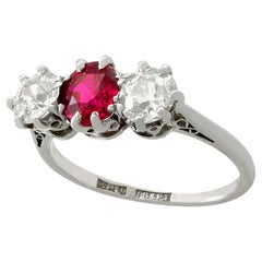 1940s 1.23 Carat Ruby 1.25 Carat Diamond Gold Platinum Set Three-Stone Ring