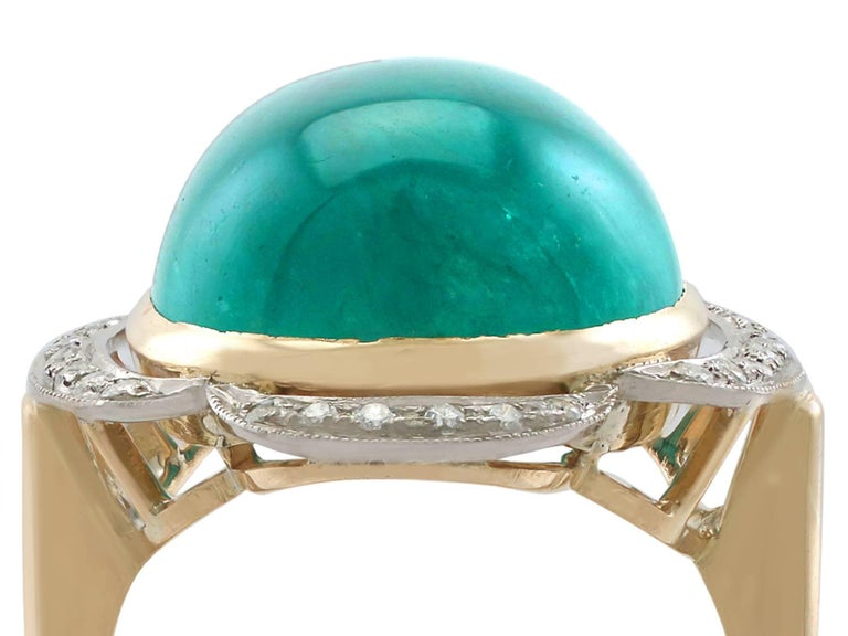 A stunning and impressive 14.5 carat emerald cabochon and 0.28 carat diamond, 18 karat yellow gold and white gold set cocktail ring; part of our vintage jewelry collections  This stunning, fine and impressive cabochon cut emerald ring has been