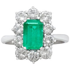 1940s 1.57 Carat Emerald and 1.72 Carat Diamond Cluster Engagement Ring
