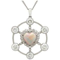 1940s 2.47 Carat Opal and 5.34 Carat Diamond Platinum Pendant