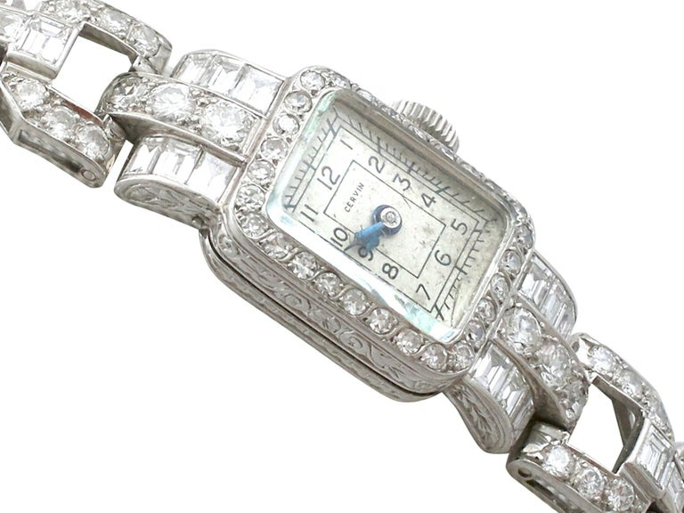 A fine and stunning vintage diamond cocktail watch in platinum, with 3.35 carat (total) diamonds; part of our diverse vintage watch and diamond jewelry collections  This stunning ladies' diamond cocktail watch made by Cervin has been crafted in