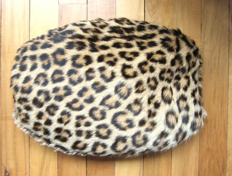 Stunning Leopard print vintage muff. Soft & Supple, no rips or smells. Zippers open on the top with opening to keep your hands toasty warm. Measures 14in. wide x 11in. high.  Visit our store front for hundreds of designer costume jewelry as well as