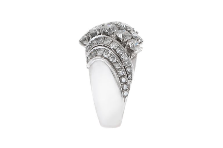 The ring is finely crafted in platinum with diamonds weighing approximately total of 3.00 carat. Size 8.00 ( easy to resize ) Circa 1940.