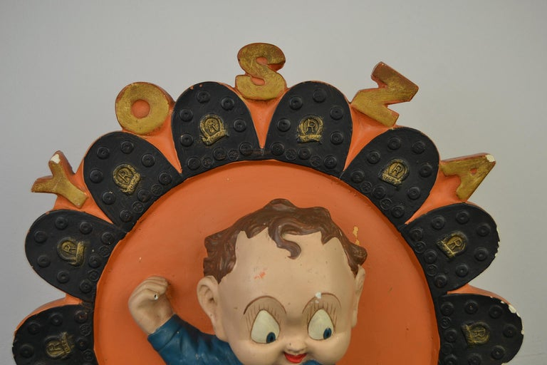 Sparkling advertising display for Yosza Soles. This painted plaster advertising object, Advertising Art was made in Belgium by F. Dengler Antwerp during the 1940s. The boy with big head is cute, comical, has large eyes and shows his sole to the