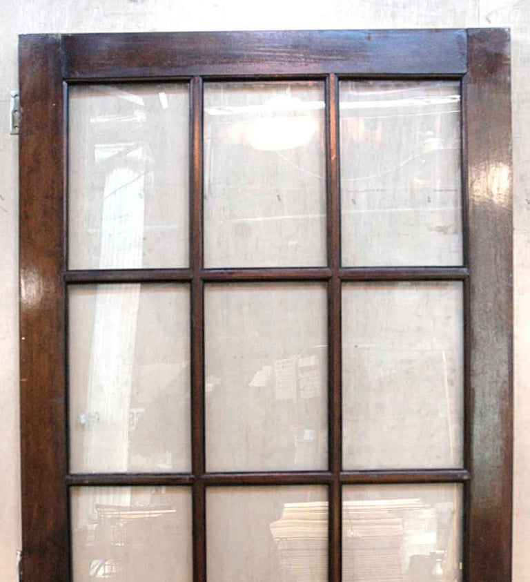 1940s birch right hand French door with 15 lites done in a dark stain. Comes with three brass hinges. This can be seen at our 400 Gilligan St location in Scranton. PA.
