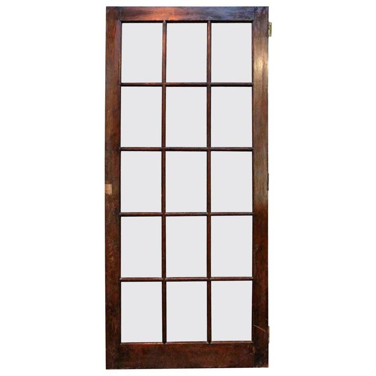 1940s Antique 15-Lite Dark Stain Birch French Door For Sale