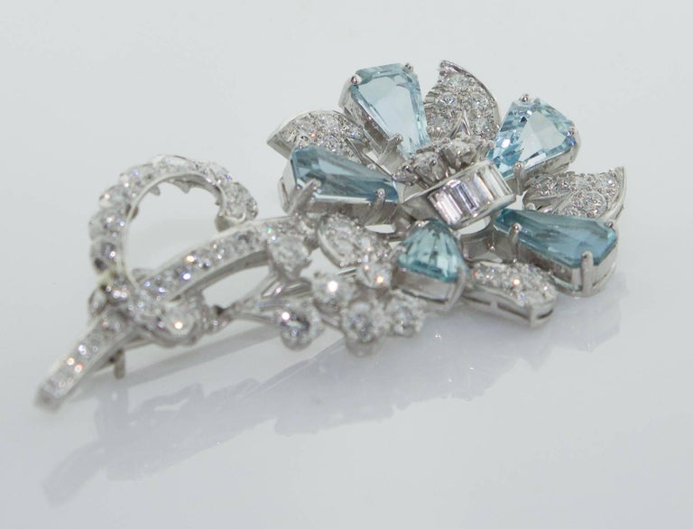 1940's Aquamarine and Diamond Flower Brooch in Platinum Five Calf's Head Cut Aquamarines Weighing 4.50 carats (approximately) Sixty Eight Diamonds Weighing 2.40 carats (approximately) Excellent Diamond Quality  GH VVS-VS1 The Workmanship is