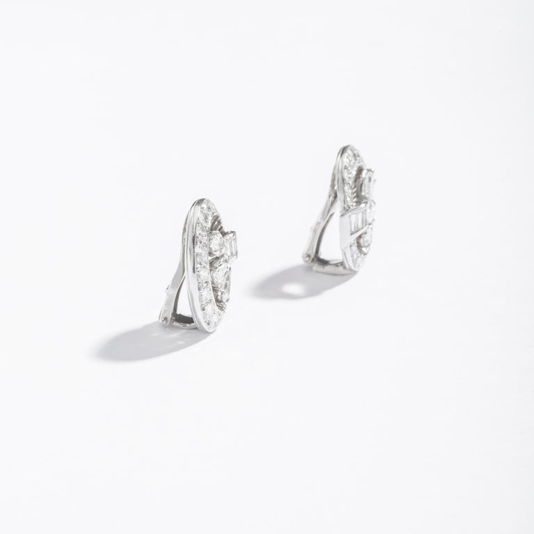 Diamond Pear Shape, Baguette and Round cut on Platinum Ear Clips. Art Deco. Circa 1940. English work.  Height: 0.79 inch (2.00 centimeters). Width: 0.71 inch (1.80 centimeters).