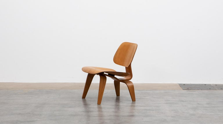 DCW Chair, plywood in ash, Charles & Ray Eames  Iconic DCW chair by famous Charles & Ray Eames. The unusual organic shape of this object shows Charles & Ray Eames innovative use of lumber-core plywood. Manufactured by Herman Miller. It dates back to