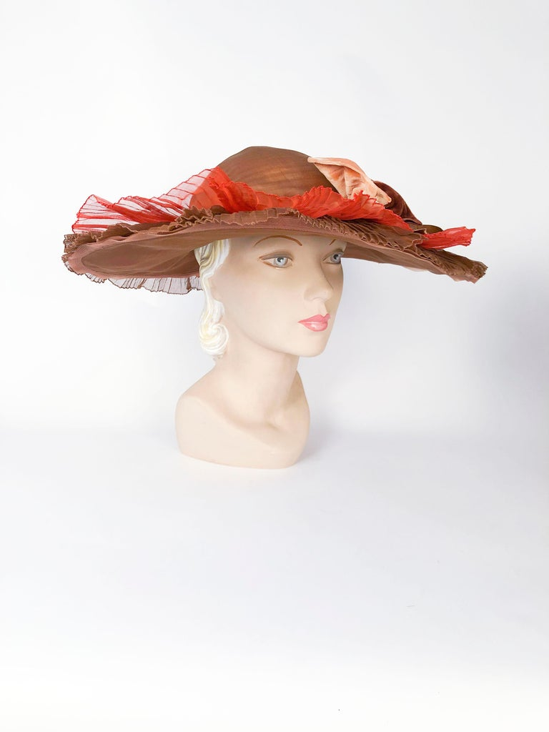 1930s/1940s Autumn-toned Horsehair Wide-Brimmed Hat with two pleated silk organza ruffles in orange and chestnut brown. Finished with a silk velvet band and an oversized multi-toned bow.