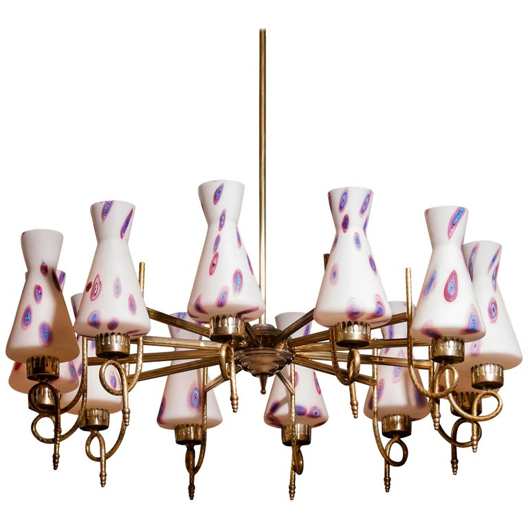 Magnificent large chandelier. This lamp is made of a beautiful brass with polished aluminium shape with twelve white designed Murano glass shades and made by Stilnovo. Dimensions: H 90 cm, ø 80 cm. Technically 100%.