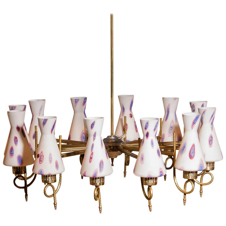 Magnificent large chandelier. This lamp is made of a beautiful brass with polished aluminum shape with twelve white designed Murano glass shades and made by Stilnovo. Dimensions: H 90 cm, ø 80 cm. Technically 100%.
