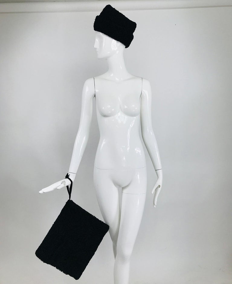 1940s Black Persian lamb angled hat and matching muff, hand warmer with zipper compartment at the back. This set will add the finishing touch to your 1940s winter outfit. The hat can be worn military style with the point in front or sideways with a