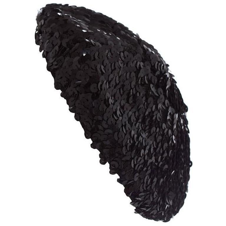 This is an original vintage cocktail hat which is very well made.  It is a black fully sequined beret style and lined in black mesh.  Of a smaller oval shape design, almost fasinator like and very easy to wear in a variety of styles.  Will add a