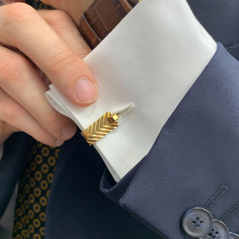 A beautiful vintage pair of signed Boucheron stirrup cufflinks set in solid 18k yellow gold.  The pair have a beautiful chevron effect finishing and function with a click-shut-fitting. The design makes the pair extremely elegant once on the cuff and