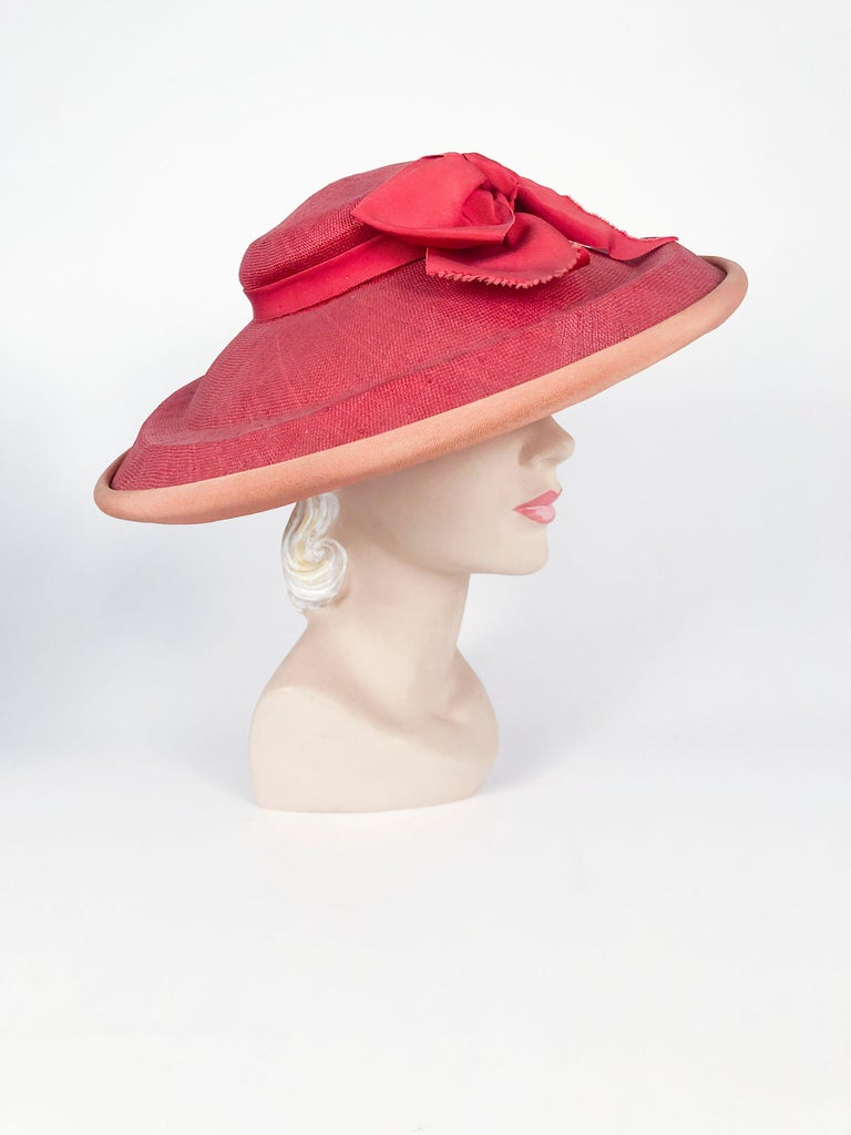 1940s coral woven straw picture hat with wide brim, gros-grain ribbon bow and contrasting trim