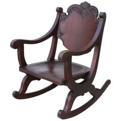1940s Carved Mahogany Rocking Chair