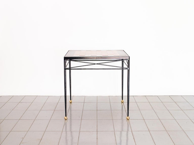 This incredible game table has a beautiful chessboard top made of white and red marble, inlaid on a black marble base. Handmade in France in the late 1940s. Great for using with two club chairs for maximum comfort.